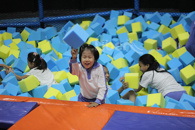 Trampoline courts with foam blocks